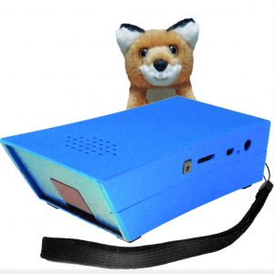 Image description: The EinkaufsFuchs and its mascot, the tiny and smart fox, which mischievously sits behind the technical aid for the blind and visually impaired.